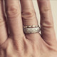 paired with the scalloped eternity ring