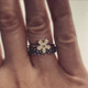 shown paired with a daisy flower ring
