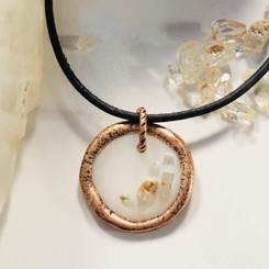 organic copper and quartz charm