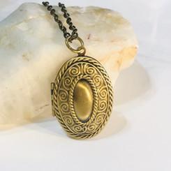 oval swirls memorial locket
