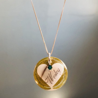 shown with birthstone charm and locket of hair added