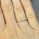 shown stacked with a scalloped eternity band