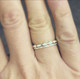 shown stacked with the scalloped eternity band