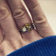 Peridot and Topaz paired with the stainless dot ring