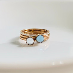 Crystal and Aquamarine paired with a thin rose gold band