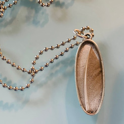 feather oval pendant