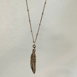 layered feather charm
