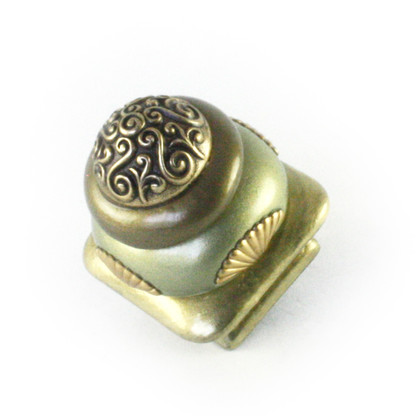 Mini Tudor knob 1.5 in. colored in light gold, jade and bronze with gold metal accents.