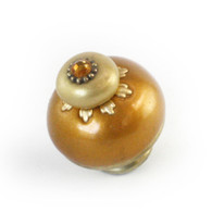 Nu Sunflower Knob gold 1.5 inches diameter has gold metal details and topaz crystal