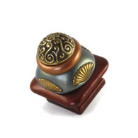 Mini Tudor square knob 1.5 inches colored in agate and deep opal with gold metal details.