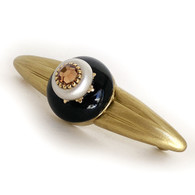 Dahlia Black orbit pull 5.25 inches with 4 inch hole span with gold metal accents and light smoke topaz crystal