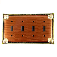 Cleo amber quad toggle switch cover with gold metal details and olivine crystals.