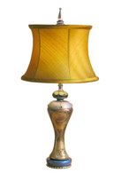 Seaside Sara lamp with drum shade in silk nugget has golden glow with light turned on.