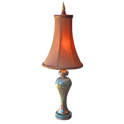 Roxy accent lamp with bell silk shade in pecan emits a warm toasty glow.