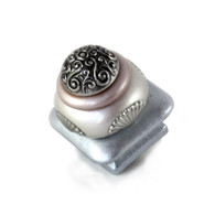 Mini Tudor knob 1.5 inches colored in light sapphire and alabaster with silver metal details