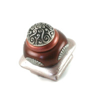 Mini Tudor knob 1.5 in. colored in light bronze, agate and coral with silver metal accents.
