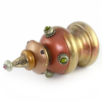 Jumbo Finial Merlin in copper amber and jade has gold metal details and olivine crystals.