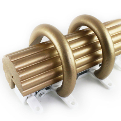 Cord Drawn Traverse 2 in. diameter reeded rod in gold paint finish with rings.