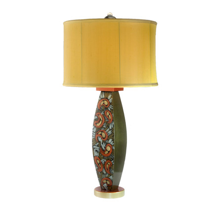 Lolita lamp  with shallow drum shade in gold silk has paint treatment in bronze, copper and aqua