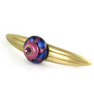 Grand Tiki Pink Orbit7 pull 7 in. with  5 in. hole span has gold metal details and amethyst crystal