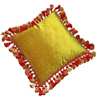 Lido pillow has duo color scheme. Covered in nugget green dupioni silk surrounded by gold and red tassel trim.