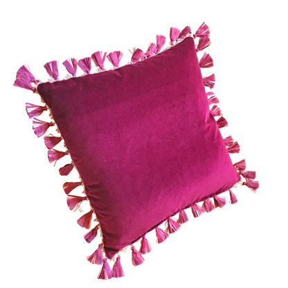 Rio pillow with tassel trim has duo color scheme. One side is lush velvet in hot fuchsia pink. The reverse is silk nugget green.