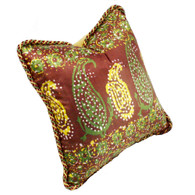 Casbah pillow mocha is covered in printed silk with paisley pattern and trimmed with a multi-color twisted rope.