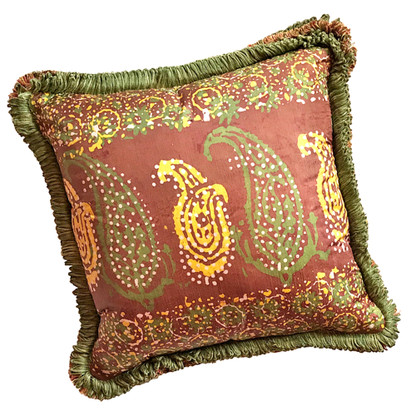 Casbah pillow with fringe trim is covered in a silk print in mocha and spruce green.
