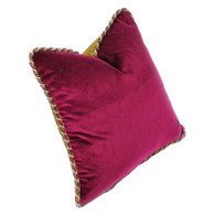 Rio Pillow with twisted rope trim has duo color scheme. One side is covered in cotton velvet in hot fuchsia pink.