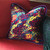 Cabo pillow covered in silk with lively colorful print