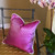 Chelsea pillow fuchsia and dot is at home with a moth orchid plant.