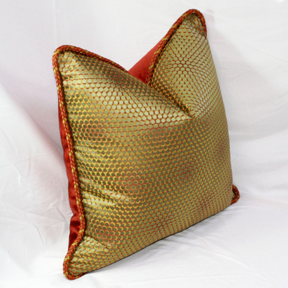 Milan pillow in olive and copper geometric print silk with twisted rope trim.