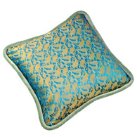 Java pillow is covered in an exotic silk print with shimmering shades of turquoise and aqua.