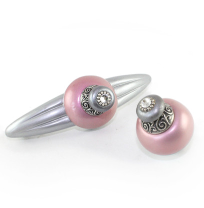 Duchess Pink orbit pull 5.25 in. with 4 in.hole span and nu duchess knob 1.5 in diameter have silver metal accents and crystal