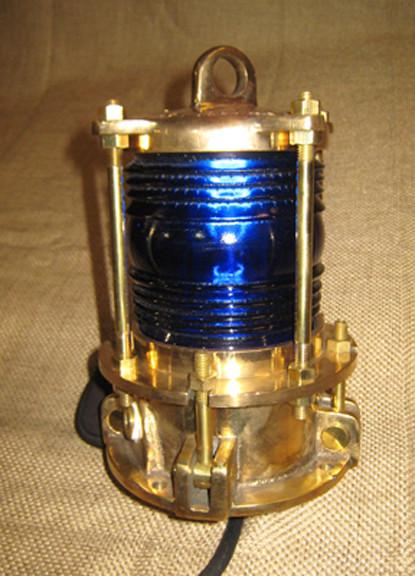 Bronze piling dock light with blue fresnel lens
