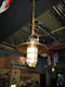 hanging hooded brass light