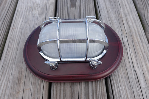 chrome nautical light with wooden trim plate