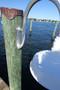 Custom Aluminum mounting pad on piling mounted wharf pole marina dock light