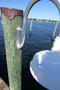 Custom Aluminum mounting pad on piling mounted wharf pole marina dock light