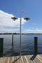 Custom fabricated aluminum wharf pole light with dual radial wave shades