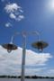 Radial wave shades on custom dual ornate wharf pole light