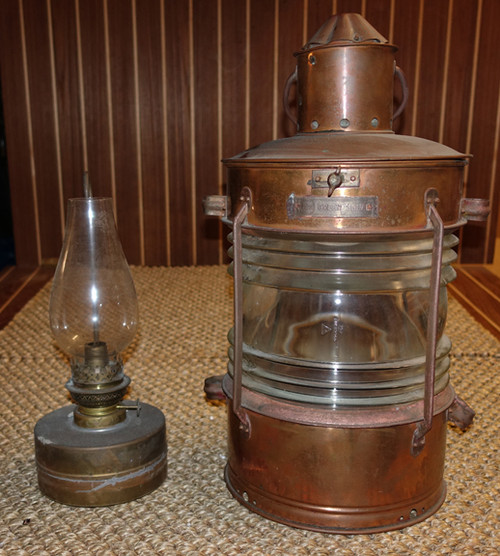 Vintage copper ship's anchor lantern with oil pod