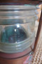 Vintage copper nautical light with fresnel glass lens