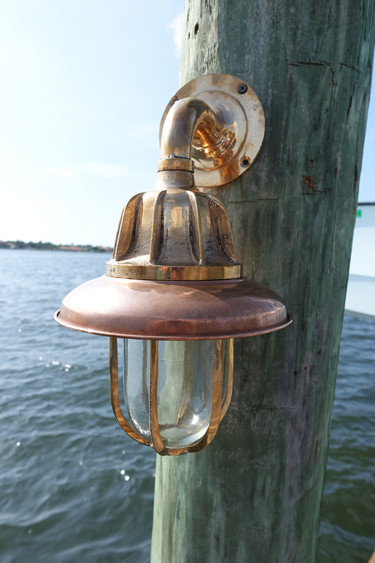 Copper hooded nautical vane style light