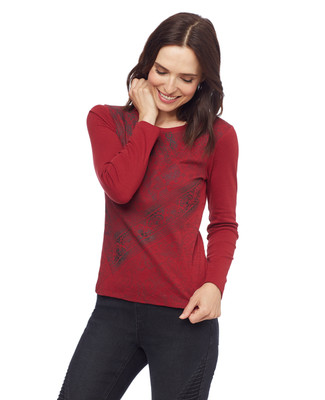 Woman in petite red patchwork top