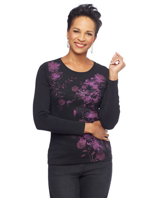 Woman in black floral crewneck sweater