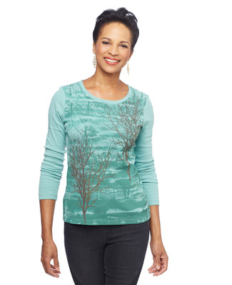 Woman in printed green lightweight cotton sweater