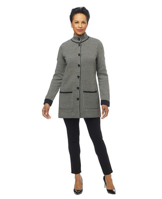 Woman in black houndstooth long coat