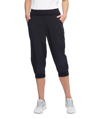Women's black loose fit travel capris with cuffed ankles