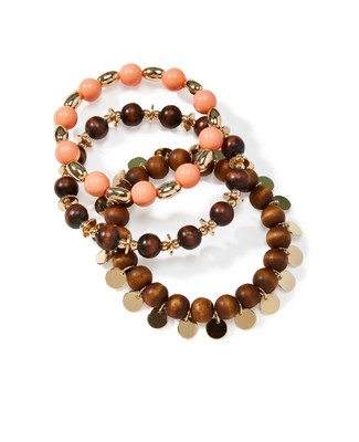 Women's matching three-bracelet set mixing wooden, peach, and gold beads.